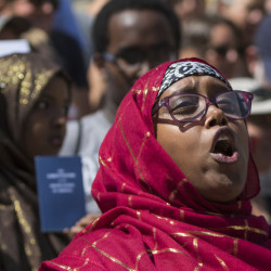Deqa Dhalac, a leader at the Somali Community Center of Maine, speaks at a rally in Portland to protest anti-immigrant comments by Donald Trump. Immigration reform is necessary for the nation and Maine.