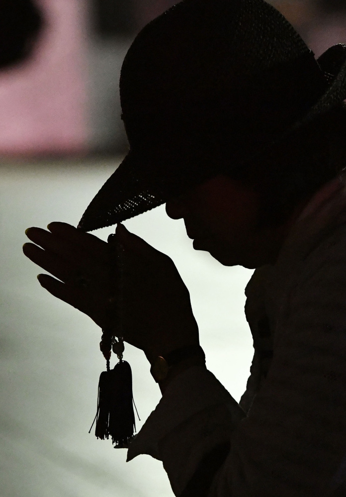 A woman prays for the atomic bomb victims at the Hiroshima Peace Memorial Park early Saturday. Japan marked the 71st anniversary of the atomic bombing on Hiroshima.