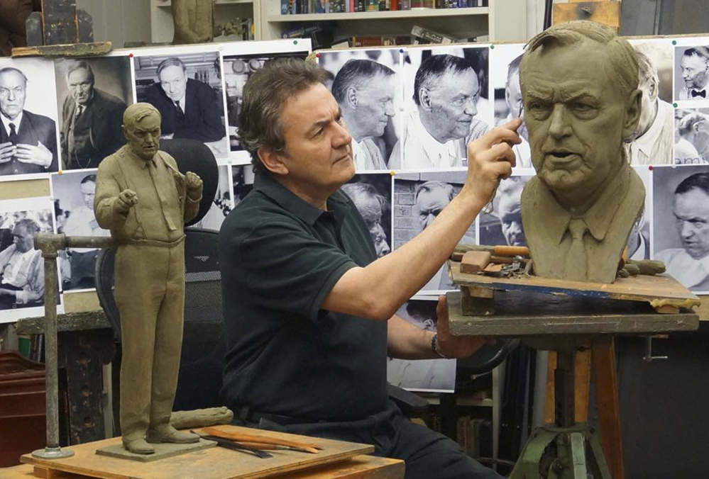 Left photo: Sculptor Zenos Frudakis works on a statue of attorney Clarence Darrow in his studio in Glenside, Penn. Right photo: A historical marker stands outside the Rhea County Courthouse where the Scopes