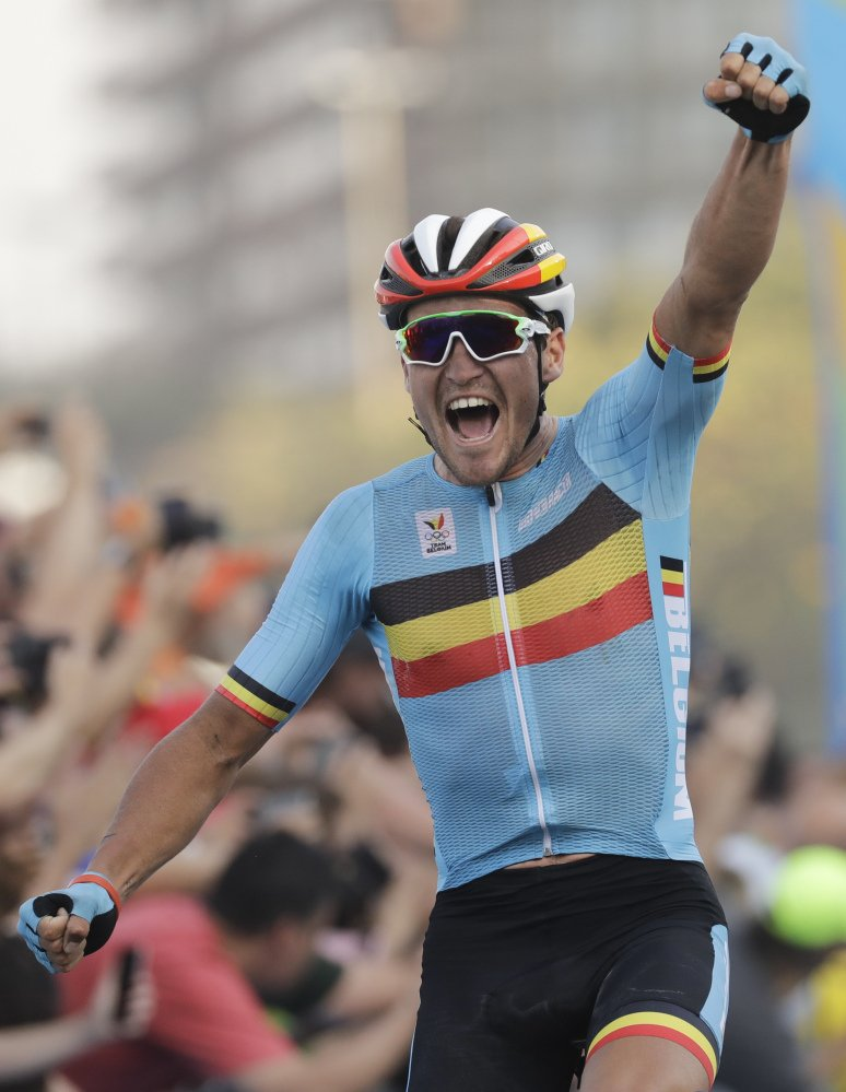 Greg Van Avermaet of Belgium celebrates after crossing the finish line to win the men's cycling road race.