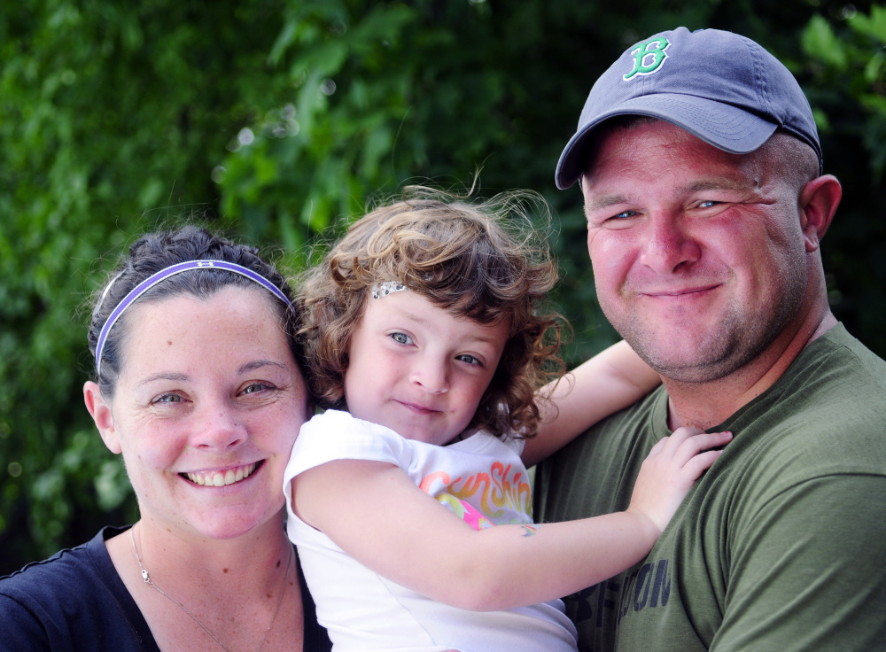 Suzanne Myers, left, and U.S. Army Sgt. Cody Myers with their daughter, Addison, on a visit with family in Augusta.