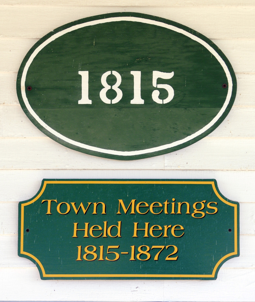 This sign tells the history of when town meetings were held in the Belgrade Townhouse, which the historical society is hoping to renovate for use as a headquarters.