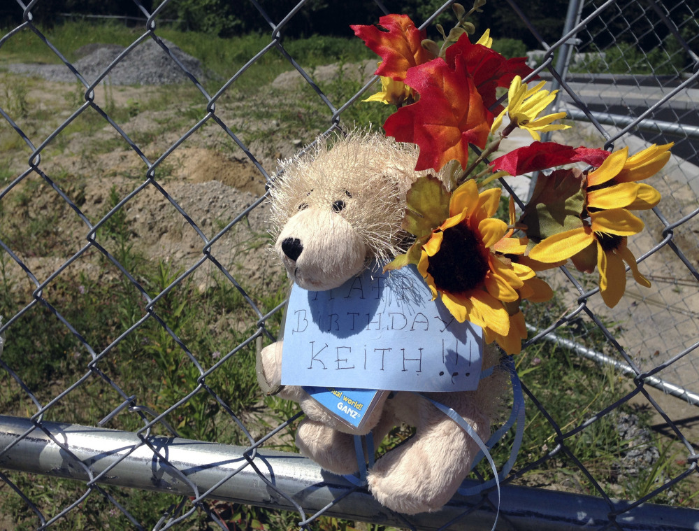 A stuffed animal hangs from a chain link fence that surrounds the site of a 2003 nightclub fire that killed 100 people in West Warwick, R.I. The memorial to mark the site of the fire is nearing completion, and organizers say they have raised more than $1.9 million out of the $2 million needed to build it and maintain it in perpetuity.  AP Photo/Michelle R. Smith