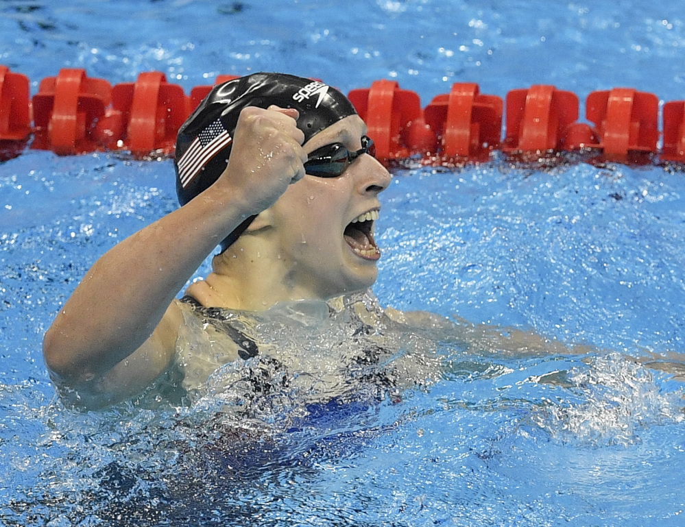 Katie Ledecky won the gold medal in the 400-meter freestyle in emphatic fashion – taking nearly two full seconds off her own world record.
