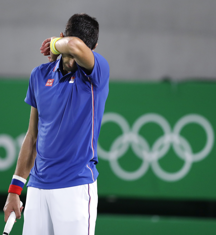 Novak Djokovic, seen during his loss Sunday night against Juan Martin del Potro of Argentina, lost his chance for a 2016 Olympic medal with a straight-sets loss in doubles Monday night.