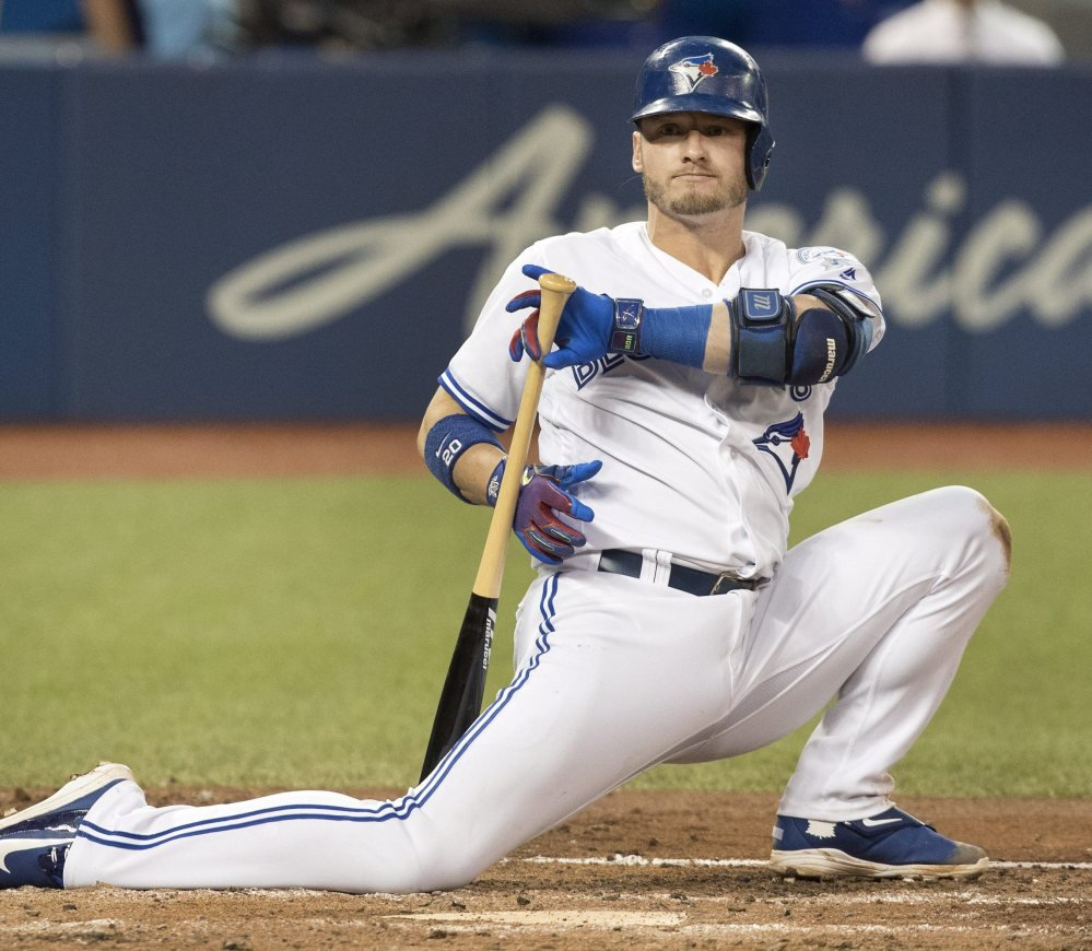 Toronto's Josh Donaldson drops to one knee after being backed off by a pitch in the fourth inning of Monday's game against the Tampa Bay Rays in Toronto.