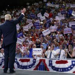 Republican presidential candidate Donald Trump waves to the crowd as he arrives at a campaign rally at the University of North Carolina Wilmington, on Tuesday.