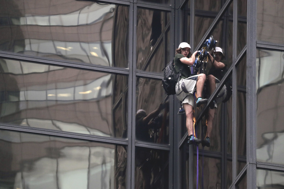 A man scales the glass facade of Trump Tower in New York on Wednesday using suction cups. The 58-story building is Donald Trump's home and the headquarters to the Republican presidential nominee's campaign.