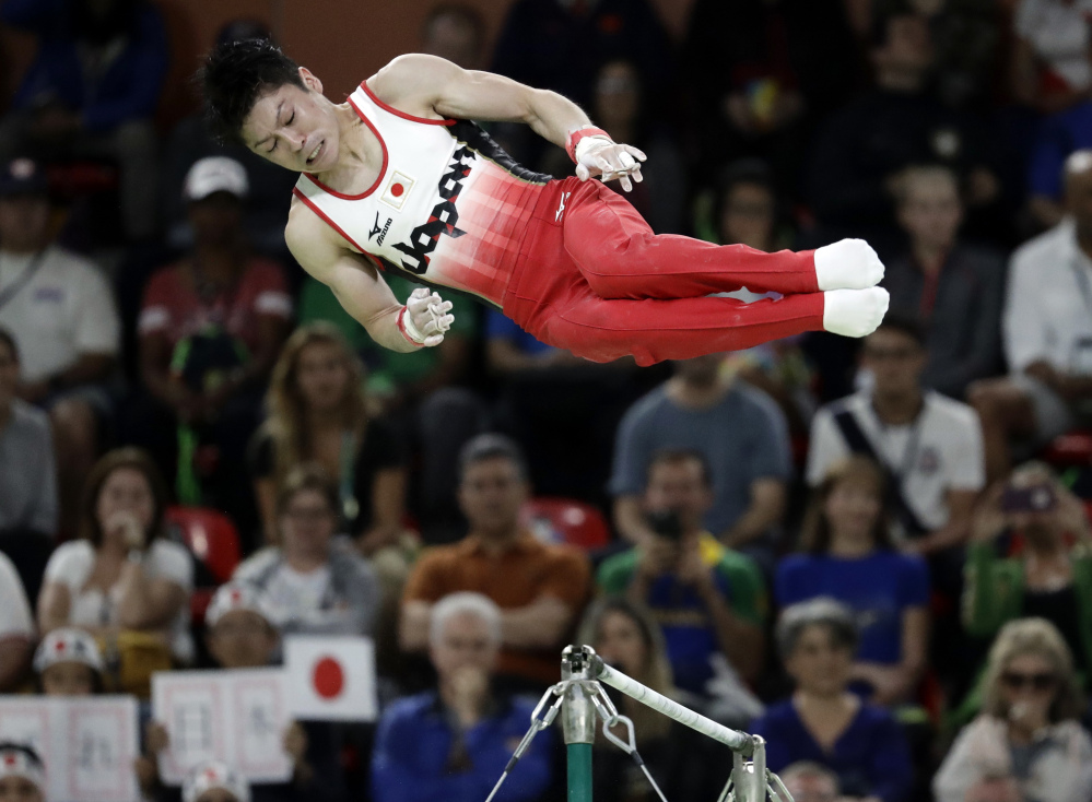 Japan's Kohei Uchimura performs on the horizontal bar Wednesday, on his way to his second straight Olympic title.
