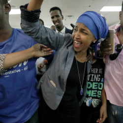 Somali activist Ilhan Omar is greeted by supporters Tuesday in Minneapolis. Omar defeated 22-term Rep. Phyllis Kahn in the heavily Democratic Minneapolis district.