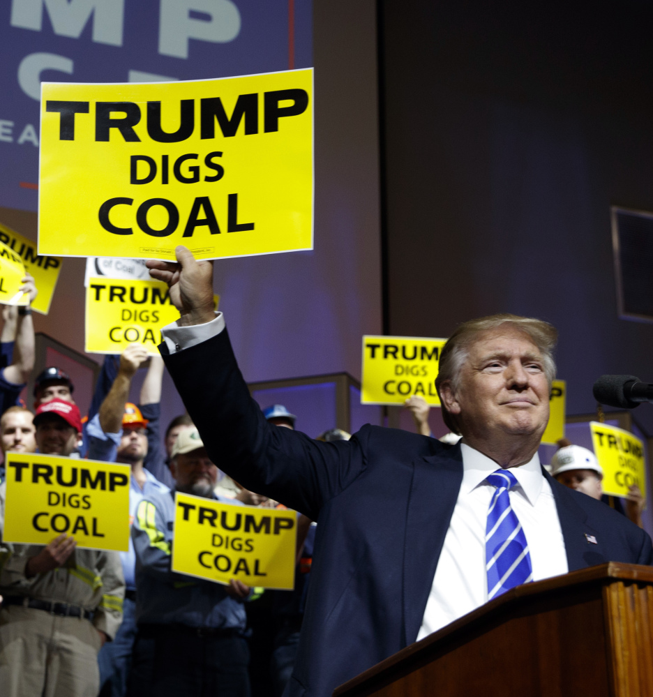 Republican presidential candidate Donald Trump seeks coal worker's votes Wednesday at a rally in Abingdon, Va.