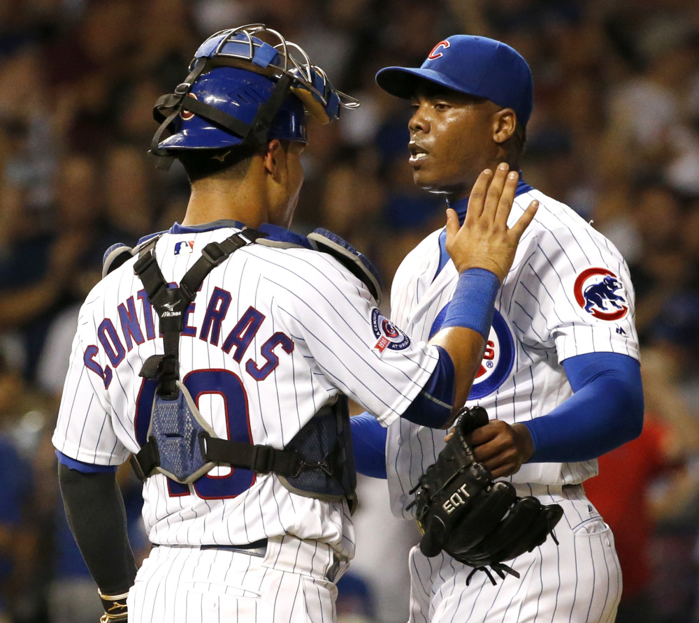 Chicago closer Aroldis Chapman celebrates with catcher Willson Contreras after the Cubs defeated the Los Angeles Angels 3-1 on Wednesday.