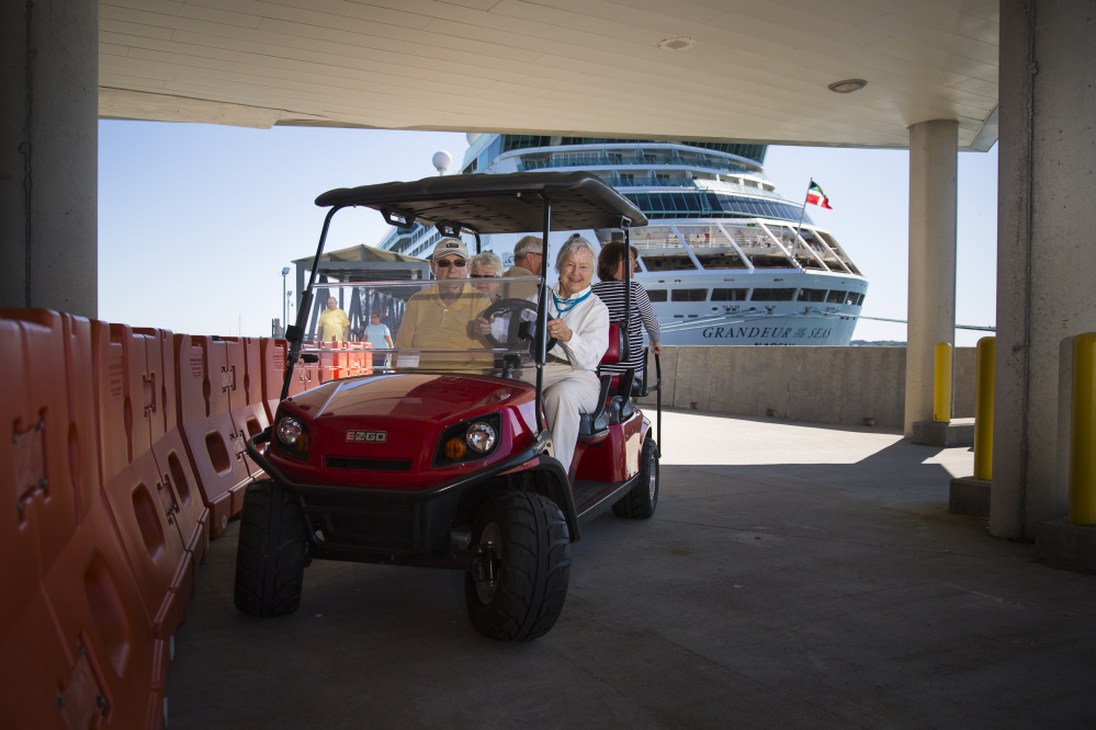 A shuttle driver prepares to transport passengers from the cruise ship Grandeur of the Seas to tour buses that await at Ocean Gateway.