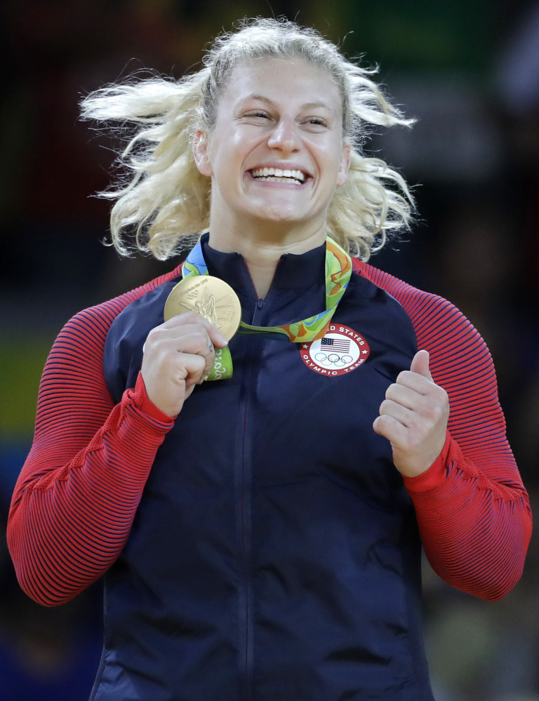Kayla Harrison has that gold-medal smile after winning the 78-kilogram class in women's judo, retaining the title she won in 2012 at London.