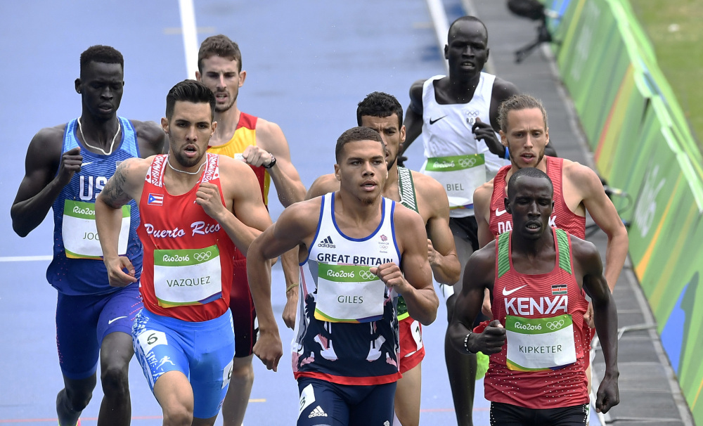 Yiech Pur Biel of the Refugee Olympic Team, rear right, runs at the back of the field in a men's 800-meter heat during the athletics competitions of the 2016 Summer Olympics at the Olympic stadium in Rio de Janeiro, Brazil, Friday, Aug. 12, 2016.