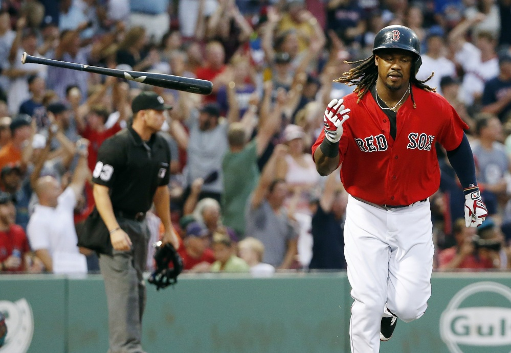 Boston's Hanley Ramirez tosses his bat after hitting a three-run home run in the first inning Friday night against the Arizona Diamondbacks in Boston.