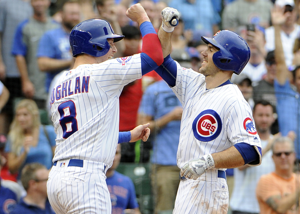 Chicago's Matt Szczur, right, is greeted by Chris Coghlan after hitting a two-run homer against the St. Louis Cardinals during the seventh inning of Chicago's 13-2 victory on Friday.