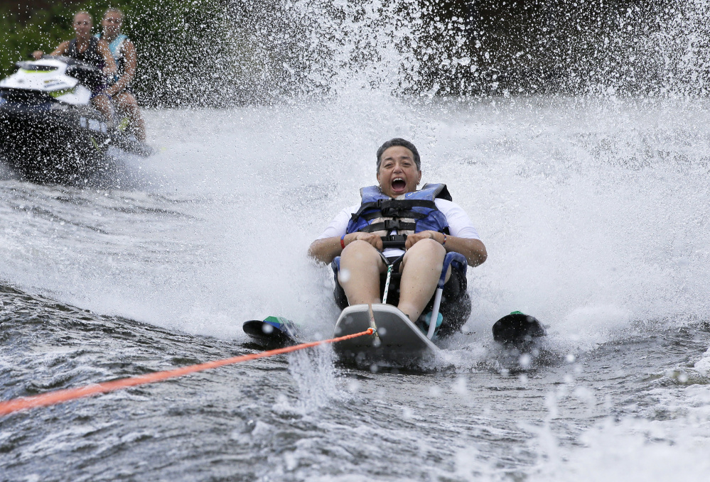 Navy veteran Raquel Ardin, who suffered a broken neck while serving in the Navy, water skis during a July rehabilitation clinic in Coventry, R.I.