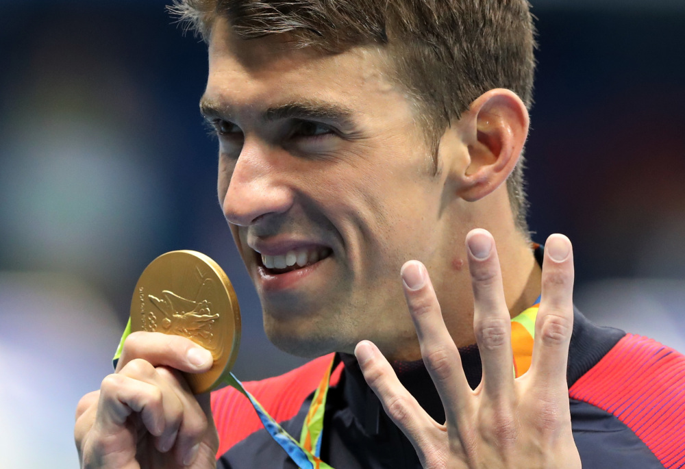 Michael Phelps celebrates winning the gold medal in the men's 200-meter individual medley during the swimming competitions at the 2016 Summer Olympics on Thursday in Rio de Janeiro, Brazil.