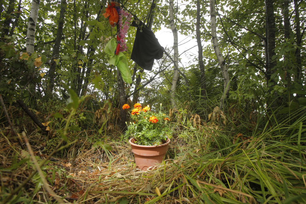 A makeshift memorial marks the North Dexter Road spot in Parkman where Pamela Burns and Russ Silva died in a car crash July 30. Piscataquis County Chief Deputy Bob Young had to break the news of their deaths to next of kin.