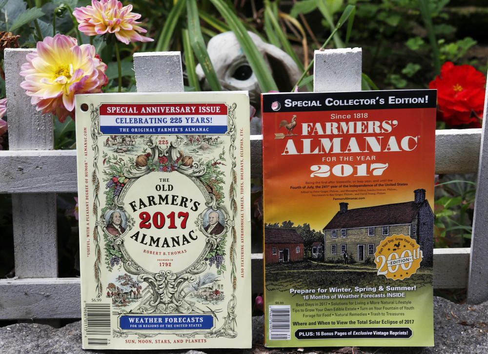 The 2017 editions of New Hampshire's Old Farmer's Almanac, left, and Maine's Farmers' Almanac photographed in Concord, N.H. The two publications, which will be released soon, are both celebrating milestones. Maine's 200 edition, and New Hampshire's 225.