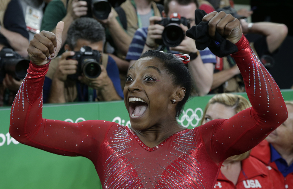 United States' Simone Biles celebrates after her winning gold in the vault at the 2016 Summer Olympics in Rio de Janeiro on Sunday. Associated Press/Rebecca Blackwell