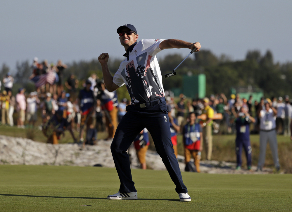 Justin Rose of Great Britain wins the gold medal in men's golf Sunday at the 2016 Summer Olympics in Rio de Janeiro.