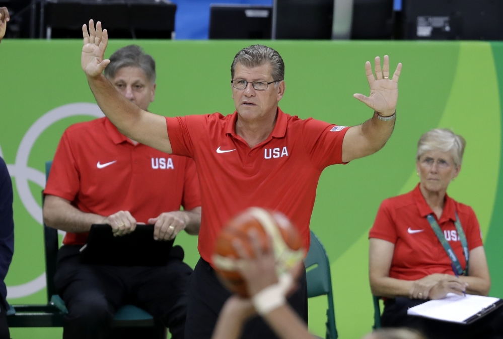 United States head coach Geno Auriemma signals from the bench during the second half of a women's basketball game against Canada at the Youth Center at the 2016 Summer Olympics in Rio de Janeiro.