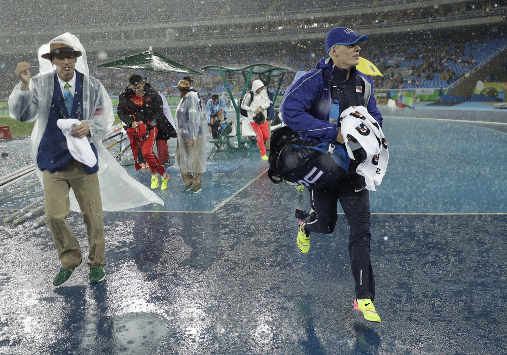 United States' Sam Kendricks leaves the field because of rain during the athletics competitions of the 2016 Summer Olympics at the Olympic stadium in Rio de Janeiro.