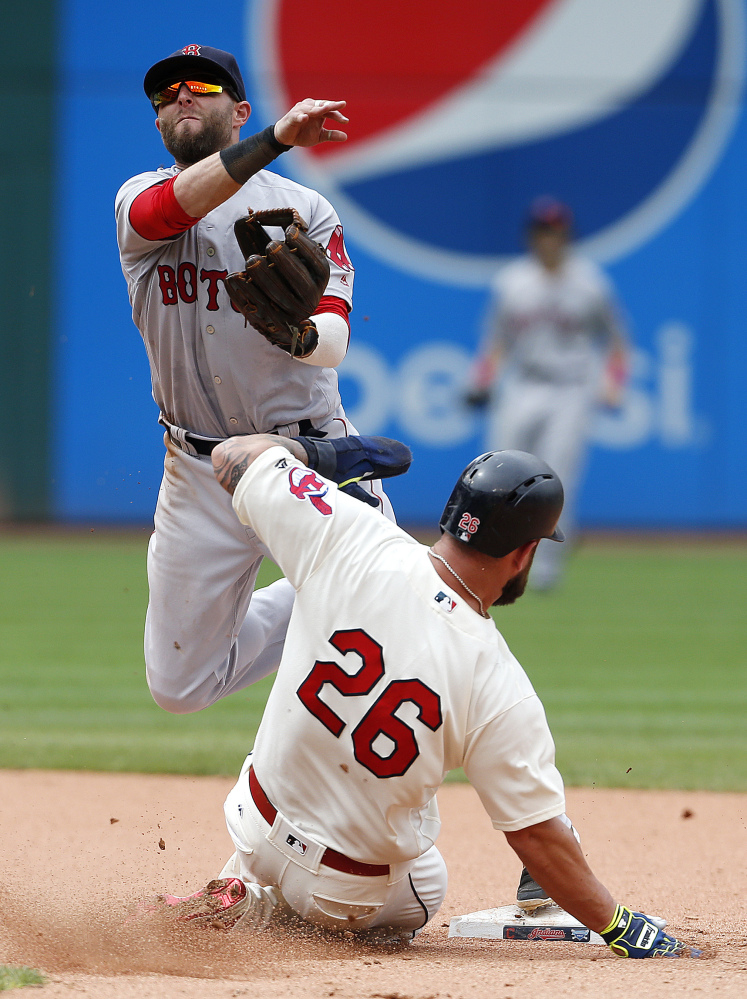 Boston's Dustin Pedroia forces out Cleveland's Mike Napoli at second base and throws out Carlos Santana at first base to complete the double play in the seventh inning Monday in Cleveland.
