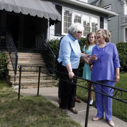 Democratic presidential candidate Hillary Clinton talks with Anne Kearns, left, as she and Vice President Joe Biden visit Biden's childhood home in Scranton, Pa., on Monday.