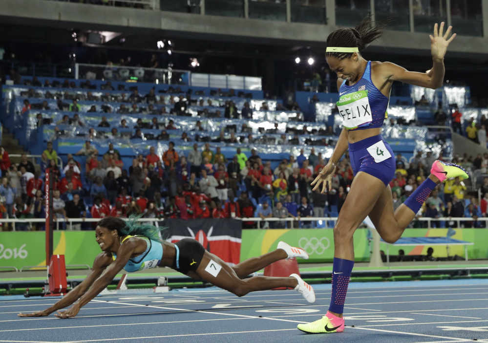 Associated Press/Matt Slocum Bahamas' Shaunae Miller falls over the finish line to win gold ahead of United States' Allyson Felix, right, in the women's 400-meter final MOnday night in Rio de Janeiro.