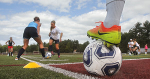 Ali Cote, left, and Alyanna Beaudoin work through a defensive drill on the first day of practice Monday for the Thornton Academy girls' soccer team. Monday was the opening day of practice for fall high school sports teams.