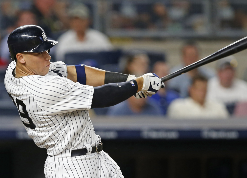 New York's Aaron Judge hits an RBI double in the fourth inning of the Yankees' 1-0 win over the Toronto Blue Jays on Monday in New York.