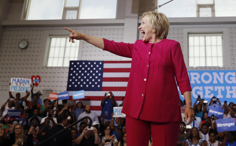 Democratic presidential candidate Hillary Clinton reacts to the cheering crowd as she arrives at a Pennsylvania Democratic Party voter registration event at West Philadelphia High School. Congress Tuesday receives notes from the FBI's interview with Clinton regarding her private email server.