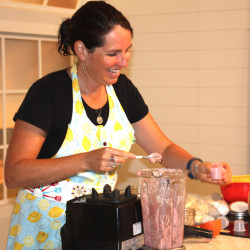 Elizabeth Fraser, who runs the Girl Gone Raw Cooking School, demonstrates how to make strawberry nice cream during the event.