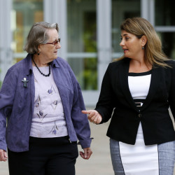 "Angela McArthur, right, director of the Anatomy Bequest Program at the University of Minnesota Medical School, walks with Jean Larson, widow of a donor in Minneapolis. Jean Larson plans to donate her body, too: ""This is the most generous donation we can make."""