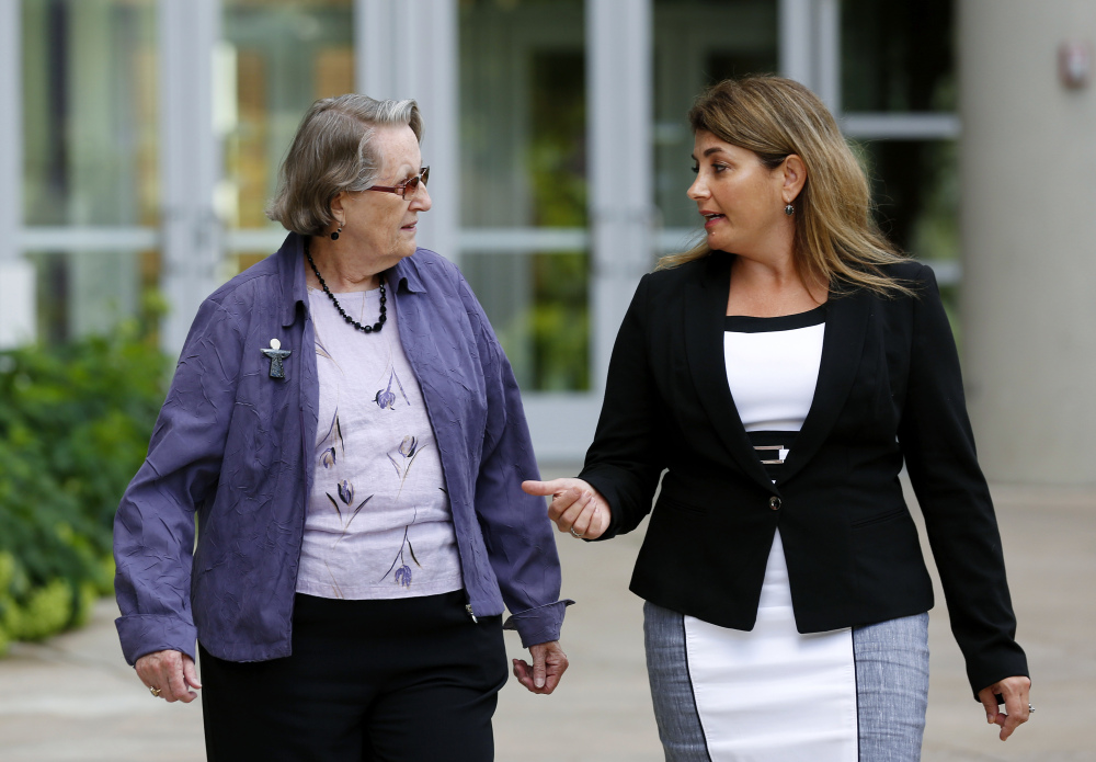 Angela McArthur, right, director of the Anatomy Bequest Program at the University of Minnesota Medical School, walks with Jean Larson, widow of a donor in Minneapolis. Jean Larson plans to donate her body, too: