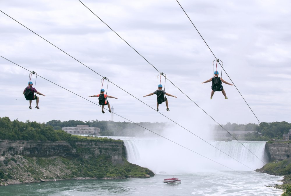 Tourists ride zip lines last month at speeds of up to 40 mph toward the mist of the Horseshoe Falls on the Ontario side of Niagara Falls.