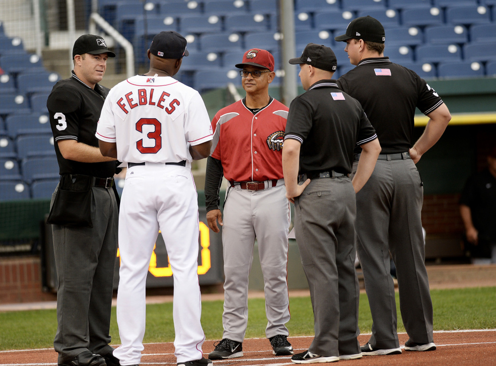 PORTLAND, ME - AUGUST 16: Portland Sea Dogs manager Carlos Febles talks with Altoona's manager Joey Cora along with umpires prior to Tuesday's game, August 16, 2016. (Photo by Shawn Patrick Ouellette/Staff Photographer)