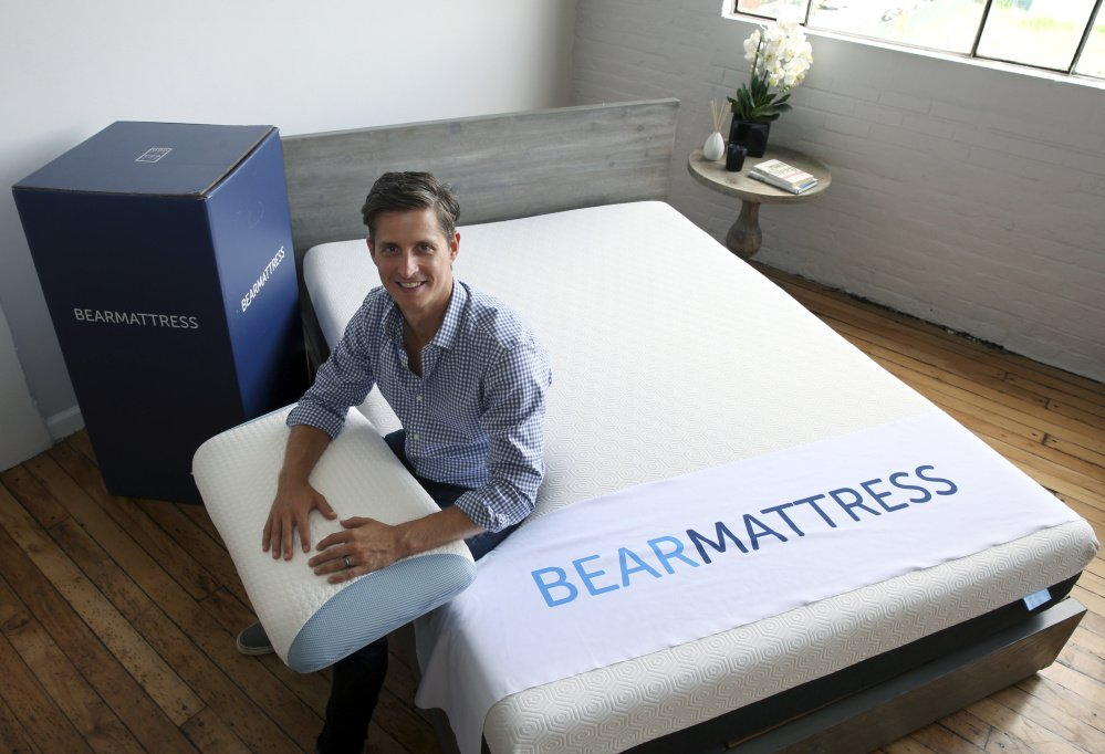 Scott Paladini, CEO of Bear Mattress, sitting with a Bear Mattress, pillow and shipping box in Hoboken, N.J.,  says 85 percent of the company's online visitors are using mobile devices.
