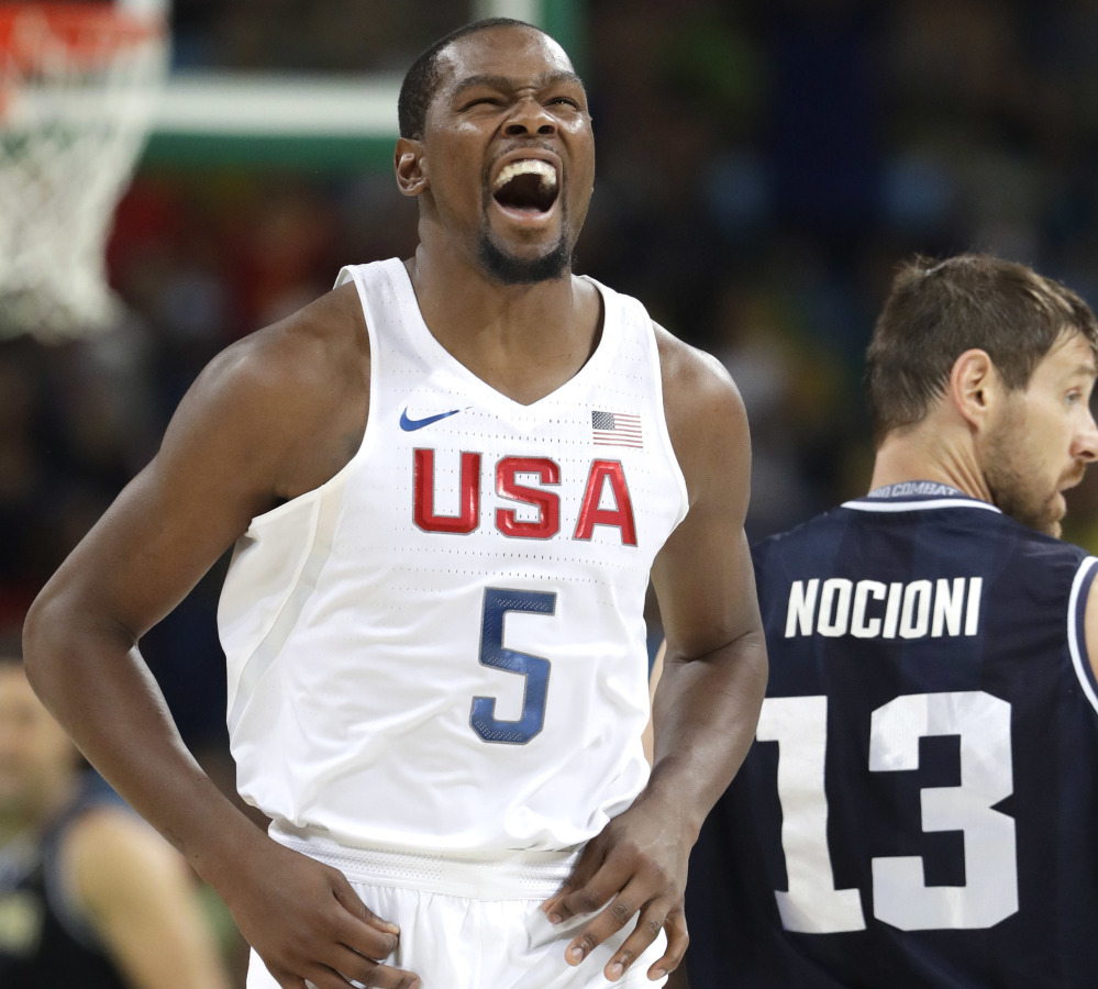 Kevin Durant, who finished with 27 points for the U.S., reacts after scoring Wednesday night during the 105-78 victory against Argentina in the men's basketball quarterfinals at the Olympics.