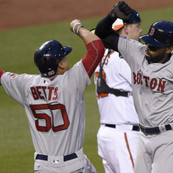 Jackie Bradley Jr. of the Boston Red Sox, right, is welcomed by Mookie Betts after hitting a two-run homer Wednesday night in the third inning of the 8-1 victory against the Baltimore Orioles.