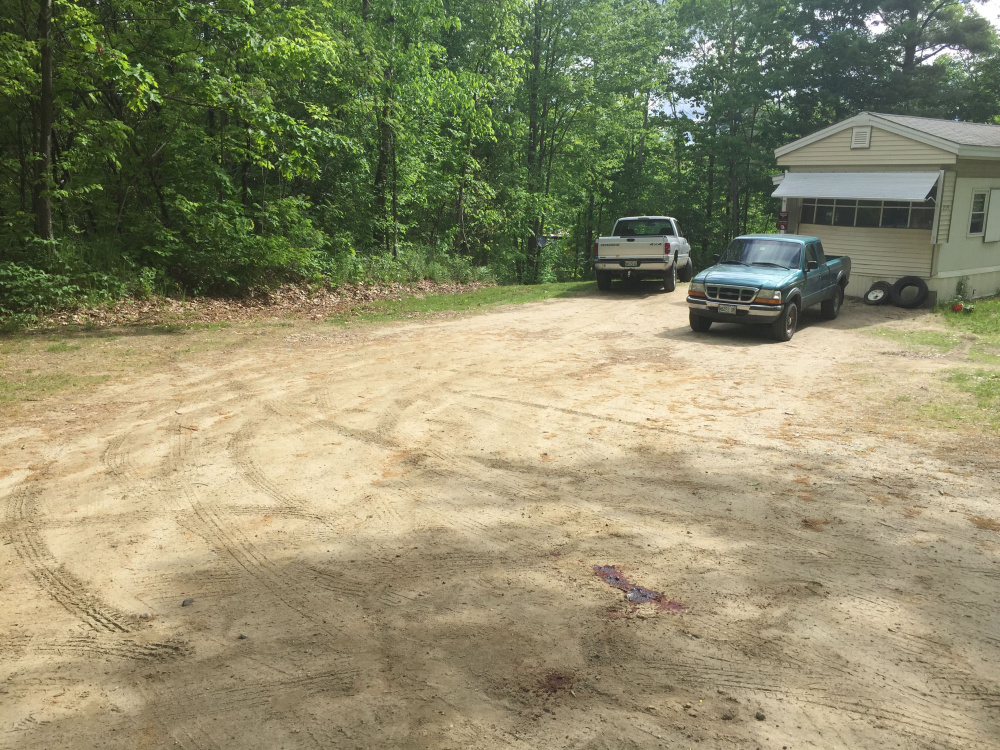 Blood pools on June 1 in the driveway at 259 Weld Road in Wilton, where police were investigating the shooting death of Michael Reis of New Sharon. Timothy Danforth, a resident of the home, was arrested Thursday and charged in the killing.