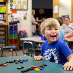 Ashton Hutchins, 5, wears a big smile in his classroom at Songo Locks School on the next-to-last day of the new Jump Start program, aimed at helping youngsters who have never been to daycare or pre-kindergarten.