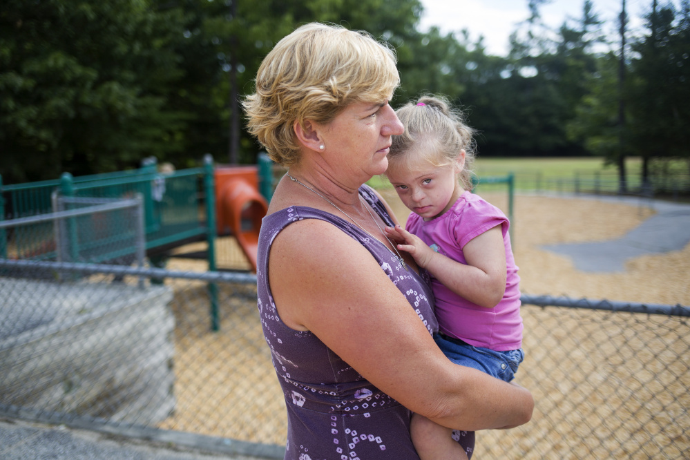 Jill Flagg holds Hannah Allen, 5, at Songo Locks School Thursday. Brianna Soukup/Staff Photographer