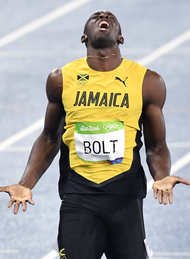 Usain Bolt of Jamaica won his third straight gold medal Thursday night in his favorite event – the 200 meters – but gave a painful reaction at the finish line, realizing he failed to break his own world record.