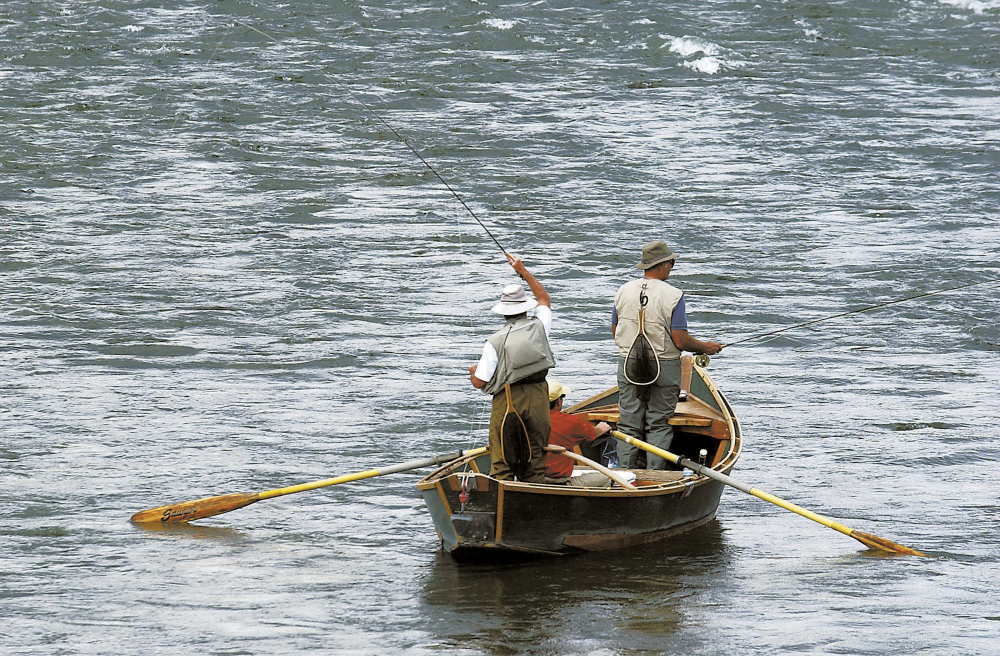 Fly fishermen test their angling skills on the Yellowstone River near Pine Creek, Mont., in September 2004. Montana officials are closing a stretch of the waterway to all recreational activities after a fish kill that was