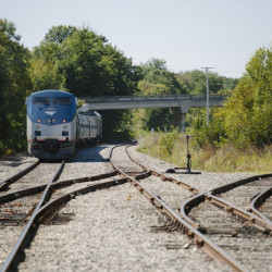 Amtrak, whose Downeaster operates in New England, has hired a new CEO it hopes will smooth the way toward growth.