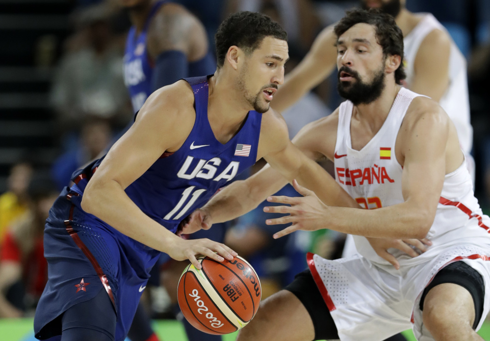 Klay Thompson of the U.S. drives past Spain's Sergio Llull during Friday's men's basketball semifinal, won by the U.S., 82-76. The U.S. vies for its third consecutive Olympic gold medal Sunday against Serbia.